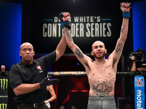 LAS VEGAS, NV - JULY 23:  Sean Woodson celebrates after his knockout victory over Terrance McKinney in their featherweight bout during Dana White's Contender Series at the UFC Apex on July 23, 2019 in Las Vegas, Nevada. (Photo by Chris Unger/DWCS LLC)
